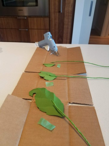 Preparing the leaves for attachment.